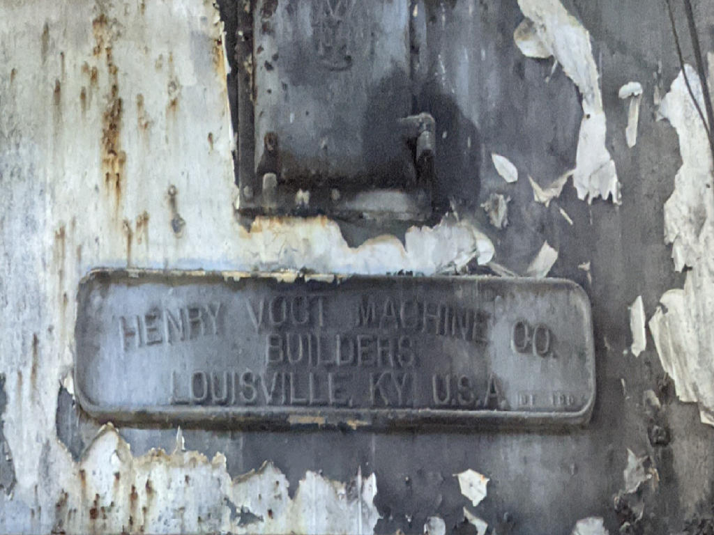 Name plate that says says Henry Vogt Machine Co