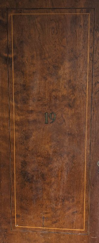 Close up of wooden door in the Administration Building.